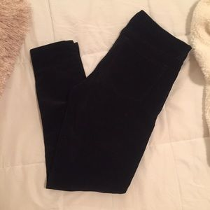 Black skinny corduroys with zip front pockets